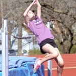 Sophomore Annabelle Cook practices her high jumps for the meet on Friday. Photo by Katherine McGinness