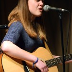 "Sophomore Iris Hyde sings her original song ""Sunscreen"". Photo by Audrey Kesler"