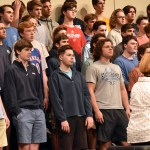 """Juniors Quin Derusseau and Henry Meeds along with senior Peter Haynes practice their song """"Hallelujah"""". Photo by Lucy Morantz"""
