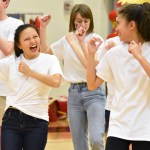 Junior Gracie Crabtree and freshman Sophie Sun laugh together during Chinese Club's Little Apple dance. Photo by Laini Reynolds