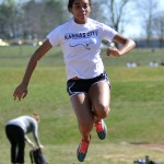 Sophomore Lauren Winston practices her long jump for the track meet on the 24th. Photo by Katherine McGinness