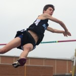 Sophomore Alec Schlote pole vaults, being one of the few athletes to make it over the bar at that height. Photo by Ty Browning