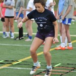 Determined, freshman Brooklyn Manning completes the ladder drill. Photo by Grace Goldman