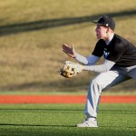 Junior Christian Flathman prepares to catch the ball during pick-off drills. Photo by Kaitlyn Stratman