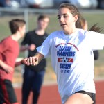 Sophomore Tatum Meyer runs the mandatory sprint for tryouts. Photo by Morgan Plunkett