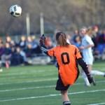 Freshman Izzy Zukaitis kicks the ball out of the goal to a teammate. Photo by Reilly Moreland