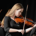 Senior Grace Kenney plays the violin. Photo by CJ Manne
