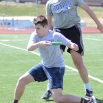 Sophomore Will Barreca pivots in front of senior Will Whekhesser to throw the frisbee. Photo by CJ Manne