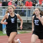 Freshman Brooklyn Beck and freshman Addison Wiklund run the 100. Photo by CJ Manne