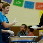 Sophomores Dane Erickson and Luke Bledsoe serve some donors their food. Photo by Luke Hoffman