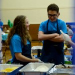 Sophomores Scout Rice and Luke Bledsoe laugh during the fundraiser lunch. Photo by Luke Hoffman