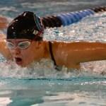Junior Grace Apodaca swims the 100 butterfly. Photo by Luke Hoffman