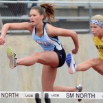 Junior Bella Stamanti competes in the 100 meter track race as she tries to beat a girl from shawnee mission south. Photo by Katherine Odell