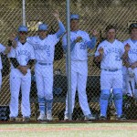 The Lancer Varsity baseball team watches the game apprehensively from the dugout. Photo by Diana Percy