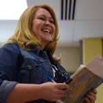 """English teacher Ms. Anderson laughs at a response to her question of the day: """"What is your greatest find?"""" She takes time out of every lesson to learn more about the students in her class, in turn allowing her students to get to know each other. Photo by Diana Percy"""