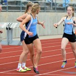 Sophomore Kara McCaskey passes the baton to junior Ingrid Worth during the '4x800 Meter Relay'. The girls finished in first with a time of 10 minutes and 5 seconds. Photo by Audrey Kesler
