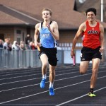Senior Alex McWard finishes the last 100 meters of his 800 meter run in the boy's Sprint Medley Relay. Photo by Laini Reynolds