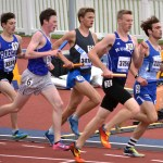 Senior Jack Young(third from the left) starts the 1200 meter leg of the distance medley relay. Photo by Laini Reynolds
