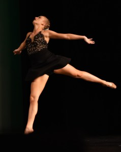 Senior Annie Smith leaps during her senior solo performance. Photo by Lucy Morantz