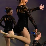 Sophomore JV Dance Team Captain Gia Hense kicks during the jazz routine. Photo by Lucy Morantz