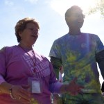 History teachers Mrs. Fishman and Mr. White share a laugh after White successfully completed the third annual Color Run to benefit East's Love Fund. Photo by Ellie Thoma