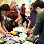 Ms. Anderson, the IB english teacher, works with students to help them create sushi rolls for their unit based on a Japanese novel. Photo by Ellie Thoma