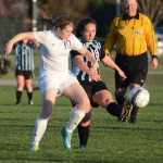 Freshman Karoline Nelson passes the ball to keep it away from her opponent. Photo by Ellen Swanson