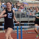 Freshman Lizzie Macadam finishes the 100 meter hurdle. She ended up taking second place in her heat. Photo by Ty Browning