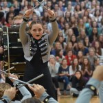 Sophomore Scout Rice puts her drum sticks in the air after finishing the dance. Photo by Reilly Moreland