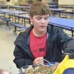 Sophomore Jack Reeves tries one of the desserts at the contest. Photo by Reilly Moreland