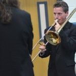 Freshman Miles Patterson practices playing his trombone before the concert begins. Photo by Reilly Moreland