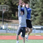 Sophomores Zach Debruyn and Charles Boerger jump up to catch the ball. Photo by CJ Manne