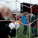 Coach Micheal Chaffee takes notes on the times of each individual in the relays. Photo by Annie Lomshek