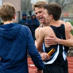 Seniors Jack Young, Will Clough, and Alex McWard celebrate winning the 4X800 relay with a time of 822.44 seconds. Photo by Annie Lomshek