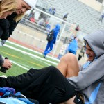 Senior Jack Young has his toe attended to by coaches Tricia Beaham and Susan Arnspiger. Photo by Annie Lomshek