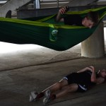 Before competing, freshman Palmer Bowles rests in a hammock while talking to freshman Seth Harden. Photo by Laini Reynolds
