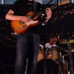 Sophomore Tom Schotte performs a guitar solo during a cover of a Grateful Dead song. Photo by Lucy Morantz