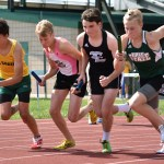 Sophomore Alex Washburn starts his first lap of the boys' 4 x 800 meter relay. Photo by Laini Reynolds