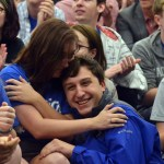Seniors Kylie Ledford and Jacob Desett hug after Ledfords nomination is announced. Photo by Katherine McGinness