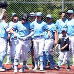 The team celebrate after Senior Jake Randa scores a homerun. Photo by Elizabeth Anderson