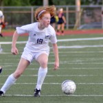 Freshman Emma Burden steals the ball from the opposing team and advances towards the goal. Photo by Izzy Zanone
