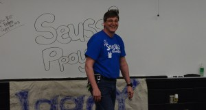 Mr. Defeo smiles as he puts up the Seussical sign before Blue Star nominations are announced. Photo by Morgan Plunkett