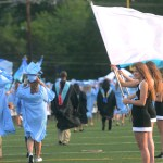 Sophomore Sophie Lawrence watches the seniors as they make their way through the flags. Photo by Grace Chisholm.