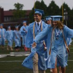 Senior Katie Kuhlman dances her way to the graduation podium. Photo by Grace Chisholm.