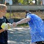 Freshman Alex Churchin splashes freshman Annie Gast with a sponge. Photo by Ally Griffith