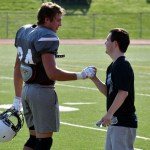 Junior Jack Melvin greets senior Harrison Gooley during the scrimmage. Photo by Audrey Kesler