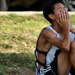 Junior Noah Manalo prepares himself to get up after the water break and return to timed figure eight drills. Photo by Lucy Morantz