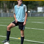 Junior Connor O'Toole rests his foot on the ball between drills. Photo by Luke Hoffman