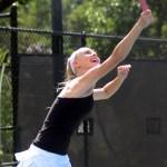 Junior Lauren Sandow smiles as she hits the ball. Photo by Hadley Hyatt