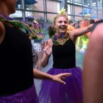 Senior Maddy Muther jumps around with fellow link crew members at the front of the dance floor. Photo by Ellie Thoma